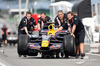 Red Bull Racing crew members with an RB4