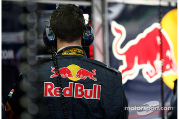 A Red Bull Racing crew member in the garage
