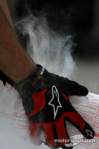 A Mechanic holding dry ice