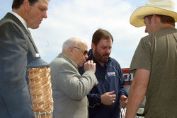 Bruton Smith and Eddie Gossage sample the Rattlesnake meat