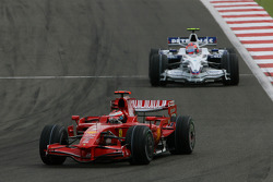 Kimi Raikkonen, Scuderia Ferrari, F2008 and Robert Kubica, BMW Sauber F1 Team, F1.08