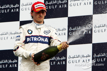 Podium: champagne for Robert Kubica