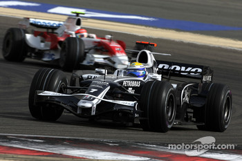 Nico Rosberg, WilliamsF1 Team, Timo Glock, Toyota F1 Team
