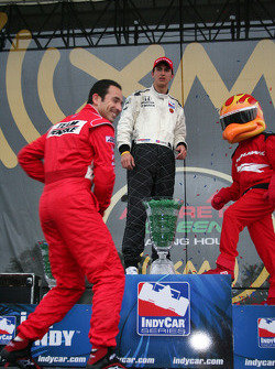 Helio Castroneves throws a hat to the crowd