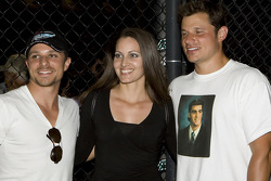 Drew and Nick Lachey, wearing Johnson's senior high school picture on his shirt, celebrated Jimmie Johnson's win with a fan photo op