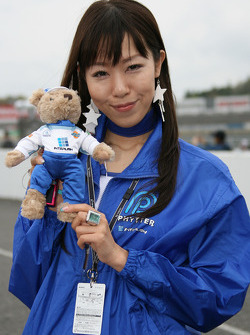 A fan poses with her bear