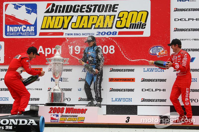 Podium: race winner Danica Patrick celebrates with Helio Castroneves and Scott Dixon