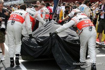 The car of Heikki Kovalainen, McLaren Mercedes is returned to the pits after he crashed