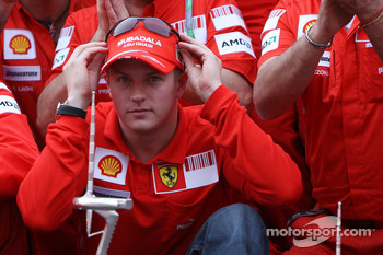 Kimi Raikkonen and Scuderia Ferrari team members celebrate win and second place