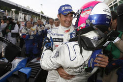 Race winners Pedro Lamy and Stéphane Sarrazin celebrate