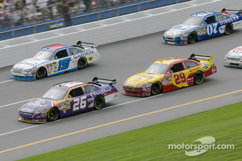 Jamie McMurray leads the pack of three during