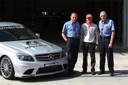 Heikki Kovalainen, McLaren Mercedes with FIA Medical Staff, Jacques Tropenat FIA, Medical Car Driver of Formula 1 and GP2 and Jean-Charles Piette, FIA Formula One Medical Delegate
