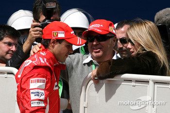 Pole winner Felipe Massa, Scuderia Ferrari with his father and his wife Rafaela