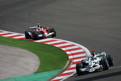 Jenson Button, Honda Racing F1 Team, RA108 and Timo Glock, Toyota F1 Team, TF108