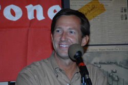 John Andretti smiles while appearing on a local radio show