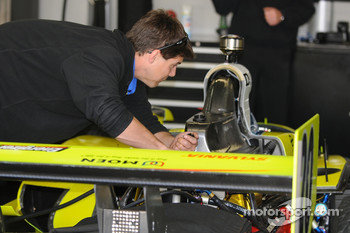A crew member working on Ed Carpenter's car