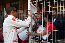 Lewis Hamilton, McLaren Mercedes, signs autographs