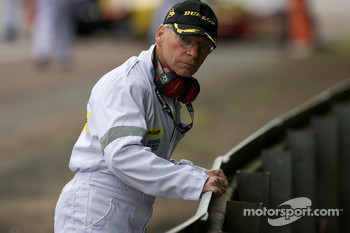 A course marshall inspects the bent armco