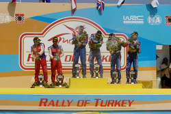 Podium: winners Mikko Hirvonen and Jarmo Lehtinen, second place Jari-Matti Latvala and Miikka Anttila, third place Sébastien Loeb and Daniel Elena