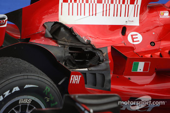 Burnt bodywork and damaged exhaust on the Ferrari of Kimi Raikkonen