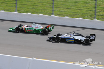 Tony Kanaan and Marco Andretti running together