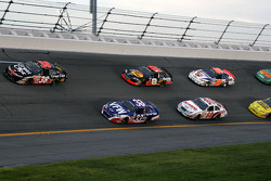 Jason Leffler and Kevin Harvick lead a group of cars