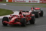 Kimi Raikkonen, Scuderia Ferrari, F2008 and Heikki Kovalainen, McLaren Mercedes, MP4-23