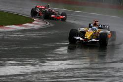 Fernando Alonso, Renault F1 Team, R28 and Heikki Kovalainen, McLaren Mercedes, MP4-23