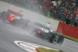 Heikki Kovalainen, McLaren Mercedes, MP4-23 and Nick Heidfeld, BMW Sauber F1 Team, F1.08