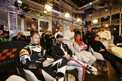 Petter Solberg and other drivers in a meeting