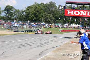 Helio Castroneves and Scott Dixon take the checkered flag