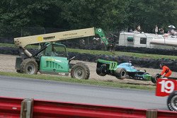 A fork lift removes Ryan Hunter-Reay's car from the gravel pit