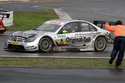 Race winner Bernd Schneider celebrates