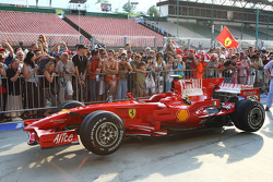 Fans in the pit lane looking at the Scuderia Ferrari, F2008