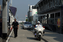 Bernie Ecclestone, President and CEO of Formula One Management arrives in the paddock with a police escort