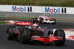 Heikki Kovalainen, McLaren Mercedes, MP4-23 leads Timo Glock, Toyota F1 Team, TF108