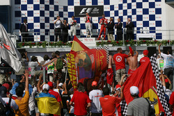 Podium: race winner Heikki Kovalainen, second place Timo Glock, third place Kimi Raikkonen