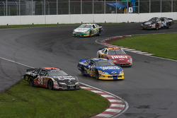Jason Leffler off-track in front of Ron Hornaday and Clint Bowyer