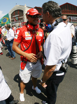 Michael Schumacher, Test Driver, Scuderia Ferrari and Dr. Mario Theissen, BMW Sauber F1 Team, BMW Motorsport Director