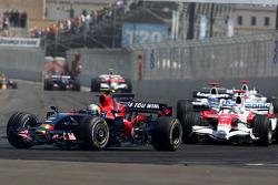 Sebastian Vettel, Scuderia Toro Rosso leads Jarno Trulli, Toyota Racing