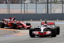 Heikki Kovalainen, McLaren Mercedes, MP4-23 leads Kimi Raikkonen, Scuderia Ferrari, F2008