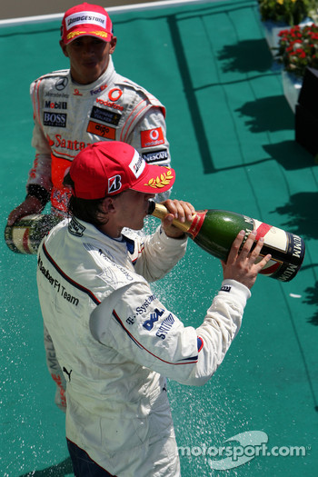 Podium: Robert Kubica celebrates with champagne