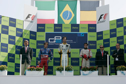 Lucas di Grassi celebrates his victory on the podium with Luca Filippi and Jerome D'Ambrosio