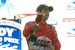 Helio Castroneves celebrates his victory
