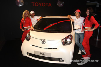 Timo Glock, Toyota F1 Team and Jarno Trulli, Toyota Racing with a Toyota IQ