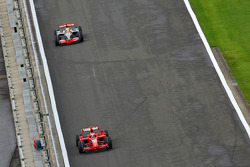 Kimi Raikkonen, Scuderia Ferrari, F2008 and Lewis Hamilton, McLaren Mercedes, MP4-23