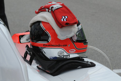 Helio Castroneves's helmet and gloves waiting to be worn