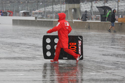 Ducati team member with a pit board