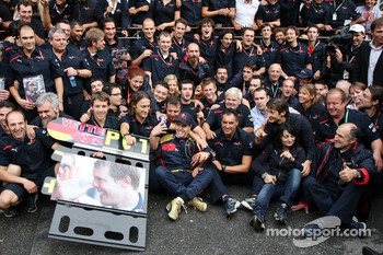 Race winner Sebastian Vettel celebrates with Scuderia Toro Rosso team members