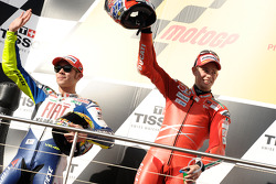 Podium: race winner Casey Stoner, second place Valentino Rossi